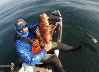 Rob Knowles with a Pacific Rockfish on a Wilderness Systems Thresher